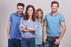 Woman leader  and her casual team smiling Stock Images