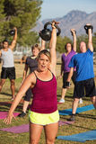 Woman Leading Strength Training Class Royalty Free Stock Image