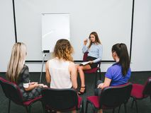 Woman leads courses improvement work skill. Woman leads courses on improvement of work skill. group session. professional training and communication Royalty Free Stock Photo