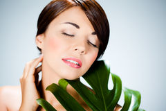 Woman with leaf Royalty Free Stock Image