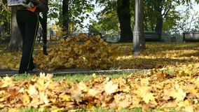 Woman With Leaf Blower In Kiev stock footage