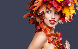Woman with leafs on head in autumn concept Royalty Free Stock Photography