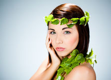 Woman with leafy vines Royalty Free Stock Image