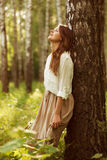 Woman leaning against birch and resting Royalty Free Stock Photo