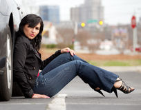 Woman Leaning Against Car With City Backdrop Royalty Free Stock Image