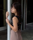 Woman Leaning Against Pillar Royalty Free Stock Photography