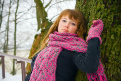Woman Leaning Against a Tree Royalty Free Stock Photography