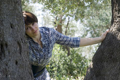 Woman leaning against tree Stock Photos