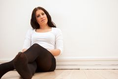 Woman Leaning Against the Wall Royalty Free Stock Photo