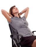 Woman leaning back on a chair Royalty Free Stock Photos
