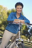 Woman Leaning On bicycle Royalty Free Stock Image
