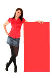 Woman leaning on a billboard. Young woman leaning on a billboard Royalty Free Stock Photos