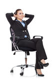 Woman leaning  in a black chair Royalty Free Stock Photos