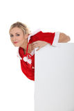 Woman leaning on blank poster Royalty Free Stock Photo