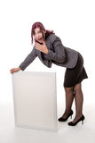 Woman leaning on a blank sign with her hands against a white bac Royalty Free Stock Images