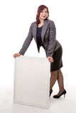 Woman leaning on a blank sign with her hands Stock Images