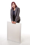 Woman leaning on a blank sign with her hands Royalty Free Stock Image