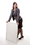 Woman leaning on a blank sign with her hands Stock Photography