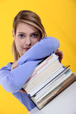 Woman leaning on books Stock Photo