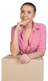 Woman leaning on cardboard box Royalty Free Stock Photography
