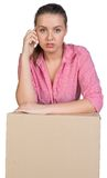 Woman leaning on cardboard box Royalty Free Stock Photo