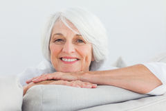 Woman leaning on a couch Royalty Free Stock Images