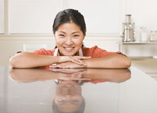 Woman Leaning on Counter Stock Photo