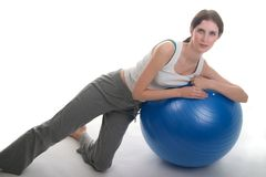 Woman Leaning On Exercise Ball Stock Images