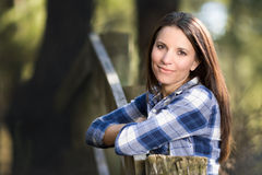 Woman Leaning on Fence Stock Photos