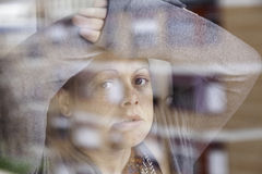 Woman leaning on glass Royalty Free Stock Photography
