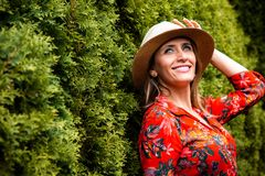 Woman Leaning on Green Grass Royalty Free Stock Images