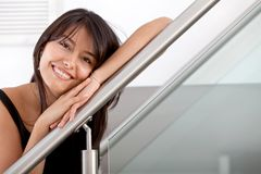Woman leaning on a handrail Royalty Free Stock Photo