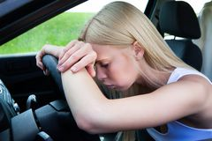 Woman Leaning Head On Steering Wheel Stock Photos