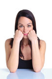Woman leaning on her hands serious expression Royalty Free Stock Image