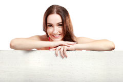 Woman leaning on her hands on white board Stock Photos