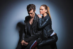 Woman leaning on her man from behind while man in leather jacket Stock Photos