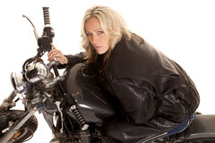 Woman leaning on a motorcycle tank look up smile Royalty Free Stock Images