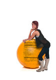 Woman Leaning on Orange with Nutrition Label Royalty Free Stock Photos