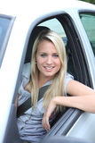 Woman leaning out of car Royalty Free Stock Photography