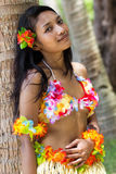 Woman leaning at palm tree Royalty Free Stock Photography