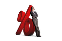 Woman leaning on percentage sign Royalty Free Stock Photos
