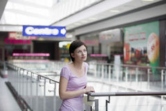 Woman Leaning On Railing In Shopping Centre Stock Image