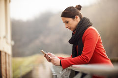 Woman leaning on a railing Royalty Free Stock Photo