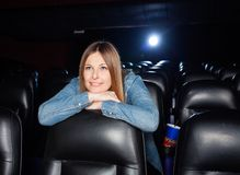 Woman Leaning On Seat At Movie Theater Royalty Free Stock Photos