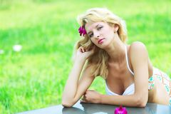 Woman leaning on table Royalty Free Stock Photo