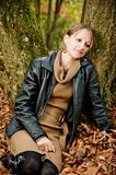 Woman leaning on a Tree Stock Images