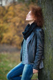 Woman leaning on the tree outdoors Royalty Free Stock Images