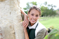Woman leaning on wall in garden Royalty Free Stock Photos