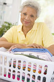 Woman Leaning On Washing Basket Stock Images