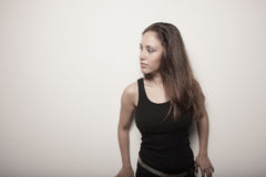 Woman leaning on a white wall Royalty Free Stock Photo